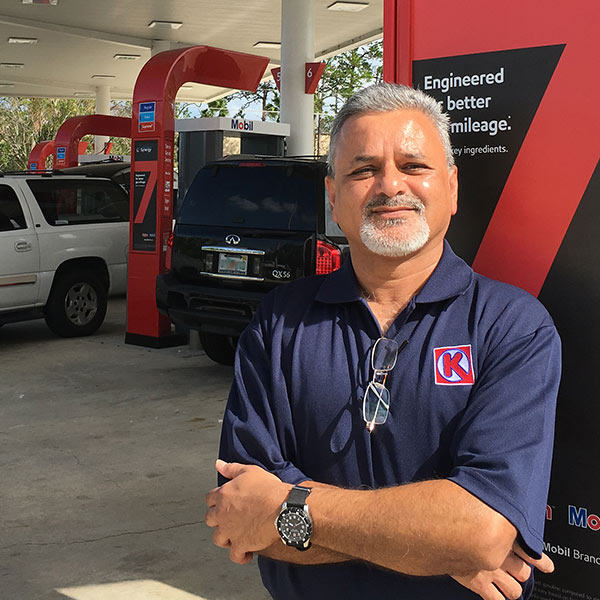 Haz Patel in front of his Mobil gas station