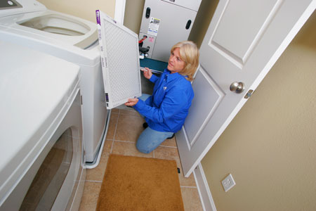 JEA_Employee_Cleaning_Home_Air_Filter