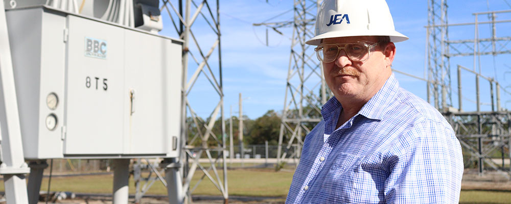 JEA Director of Asset Management, Andy, touring a substation facility