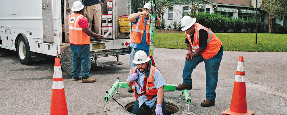 Men working in man hole